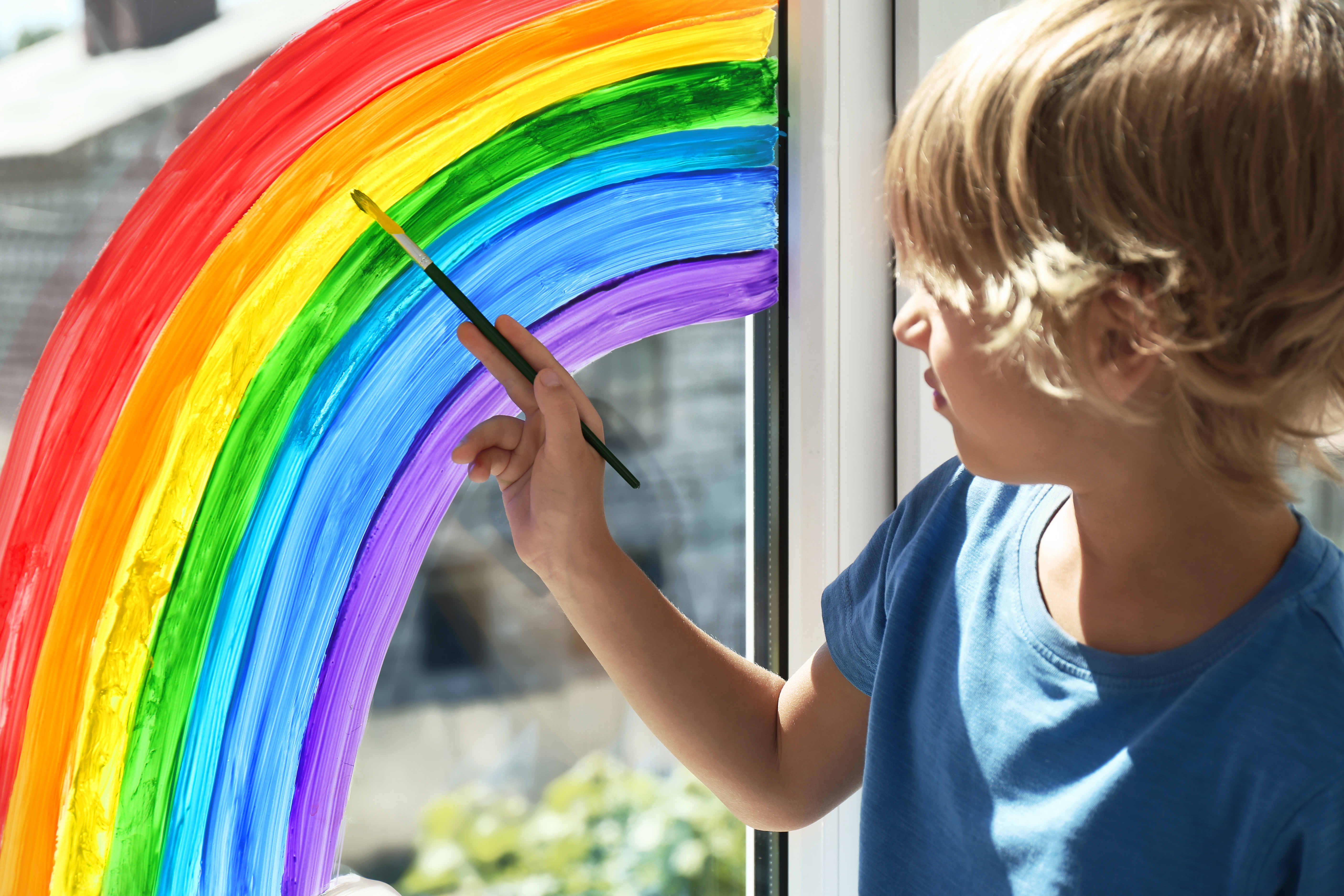 Child Painting a Rainbow